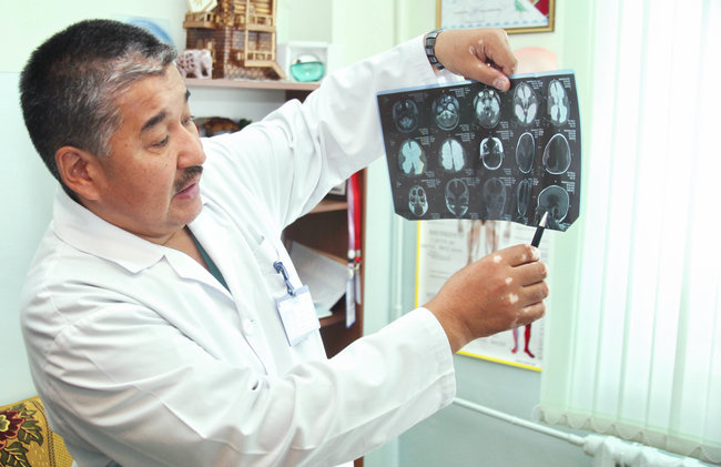 UNICEF Image: A doctor in Kyrgyzstan holds up a medical chart