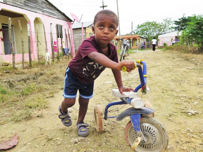 UNICEF Image: A boy pushes a bike in the Dominican Republic