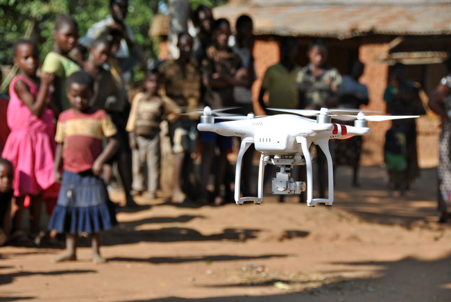 UNICEF Image: A crowd watches a drone take off in a village in Malawi