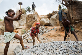 Chidren breaking stones at a quarry