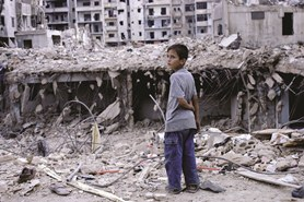 Displaced boy in destroyed area
