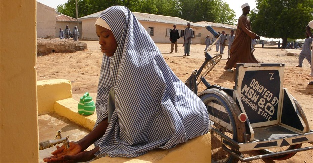 UNICEF Image: Nigeria, 2008: Hafisa Salisu washes her hands at a latrine block in Zamfara State. New latrines and hand-washing stations were built to accommodate disabled children.