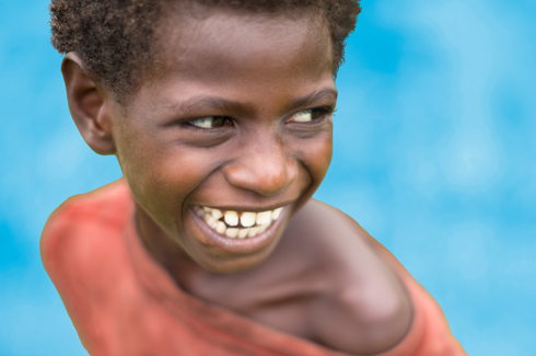 Child, smiling. Detail from cover of The State of the World's Children 2016 report