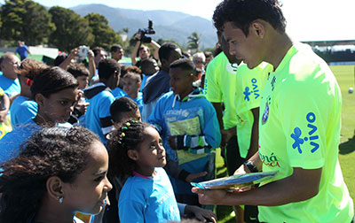 UNICEF Image: Thiago Silva, the captain of Brazilian National Soccer Team, talked to the children after a training session. It was part of We Can Be Even Better, a UNICEF campaign about the right to sport.